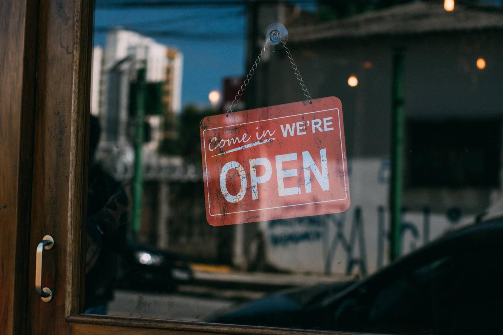 open sign hanging on a door